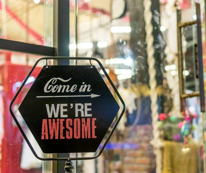 A UK small business with a sign on the door saying ! Come in, we're awesome!""